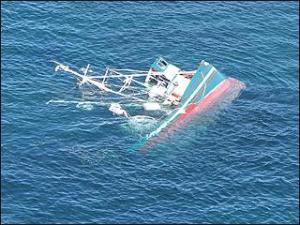 3516542213_070831_boat_capsize_xlarge